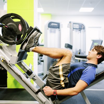 Weight training in the gym, using a leg press