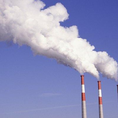 Smoke emitting from chimney stacks