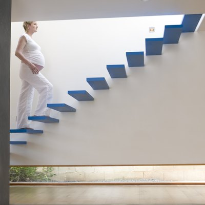 Pregnant woman walking up stairs
