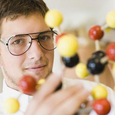 Student holding a molecular model