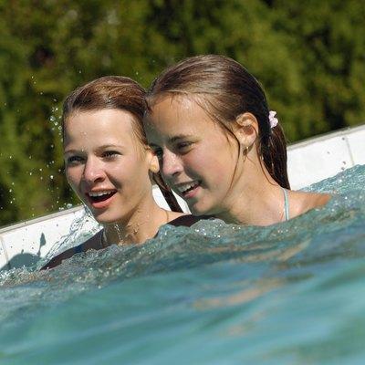 Two teenage girls in a swimming pool