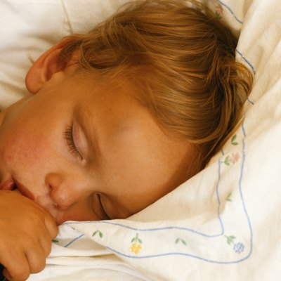 Boy (4-5) sleeping, thumb in mouth, close-up