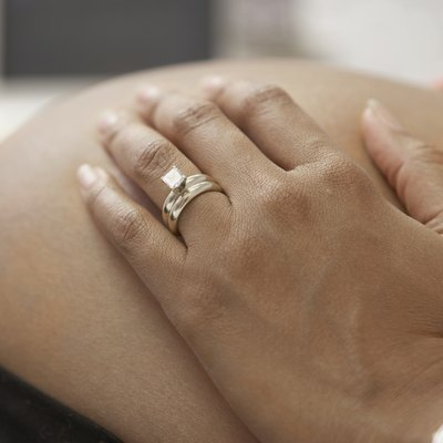 Close up of pregnant African woman's hand on bare belly
