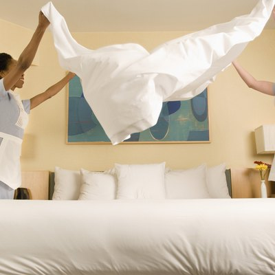 Maids making bed