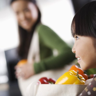 Side view of girl with bag of produce