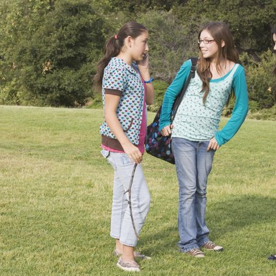 Hispanic teenaged girls in park
