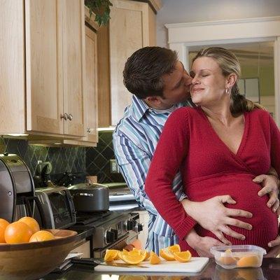 Man hugging pregnant woman