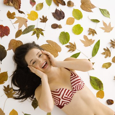 Girl in lingerie with leaves
