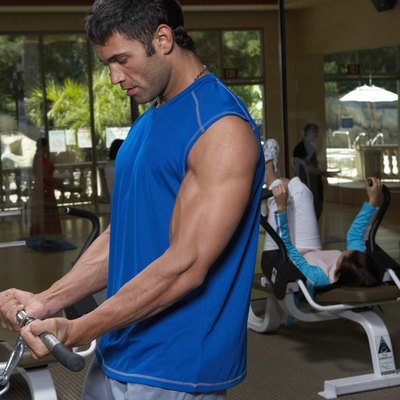 Man doing exercise in gym, close-up