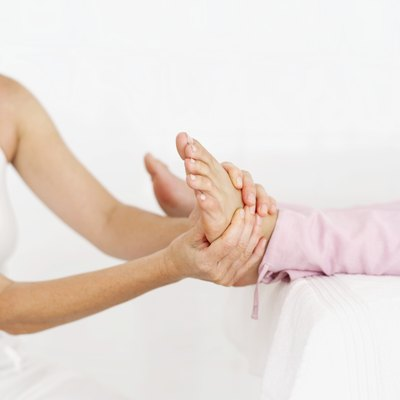 Young woman getting a foot massage