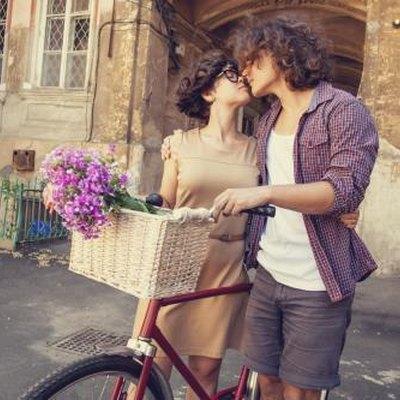 Couple with bike near house.