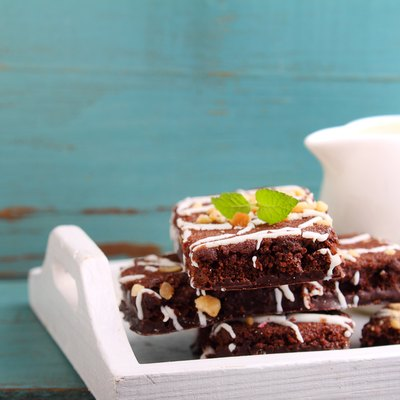 chocolate brownie cake with nuts and ising
