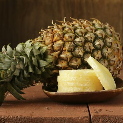 dessert pineapple sliced on a wooden plate