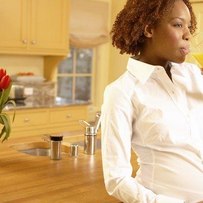 Pregnant woman with orange juice