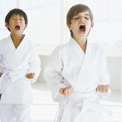 two boys practicing judo