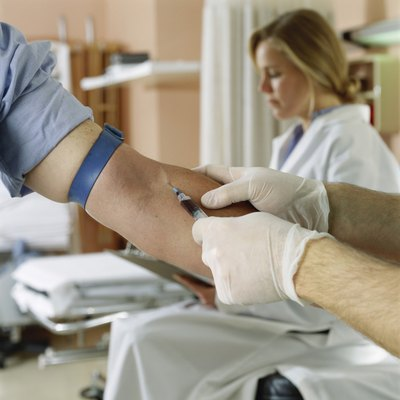 Male doctor taking a blood sample