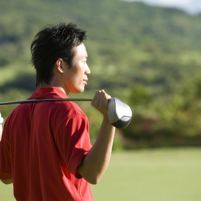 Man Holding Golf Club on His Shoulder