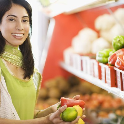 Woman grocery shopping for vegetables
