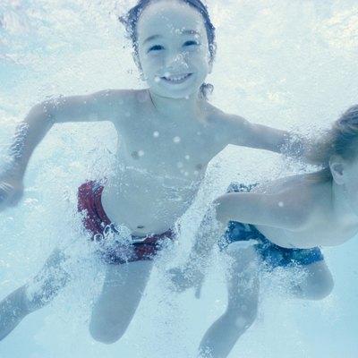 Two children swimming underwater