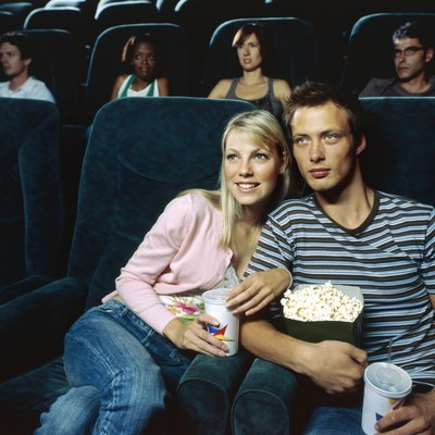 Young couple watching movie in a movie theatre