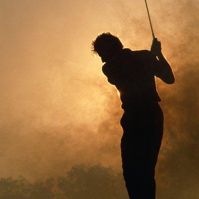Silhouette of golfer