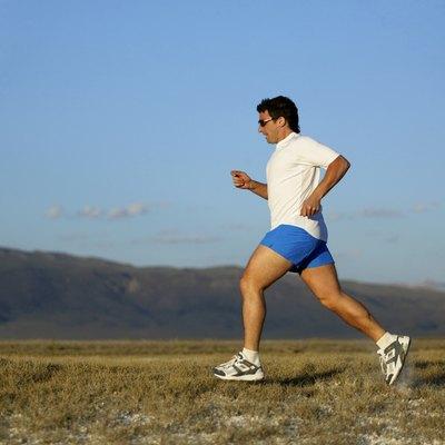 Man running with mountains,  California,  USA