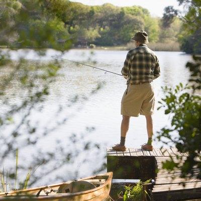 Man fishing on dock
