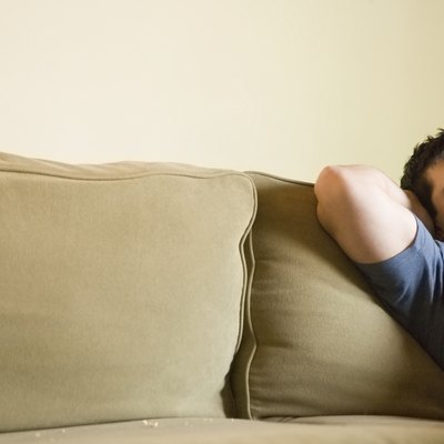 Mature man relaxing on sofa