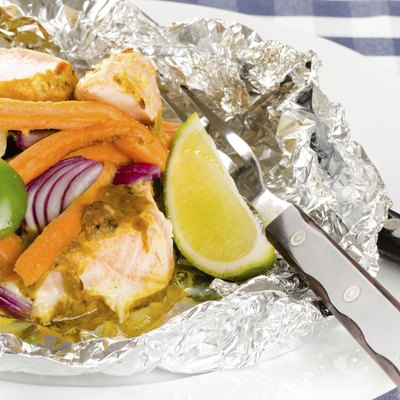 baked salmon with vegetables in a foil