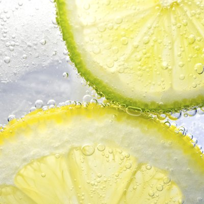 Lemon and lime in glass