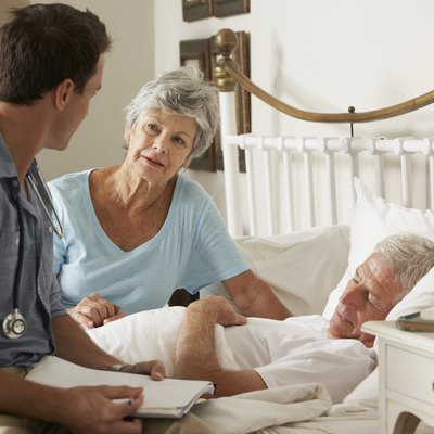Doctor On Home Visit Discussing Health Of Senior Male Patient
