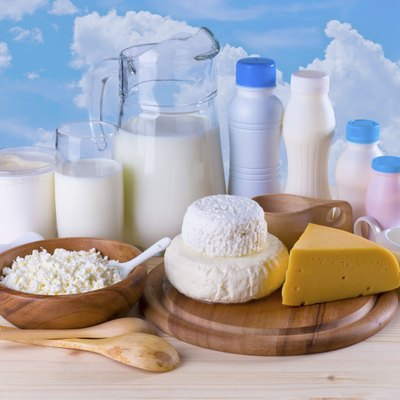 Composition of dairy products on sky background