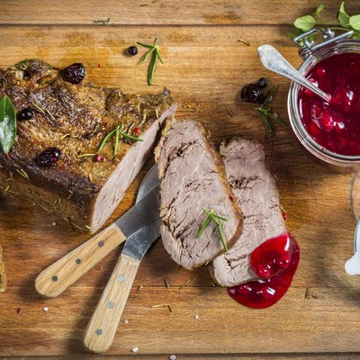 Freshly served venison with cranberries and rosemary
