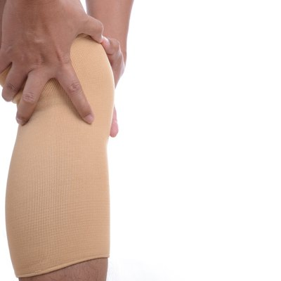 Man leg with brace knee support protection pain problem