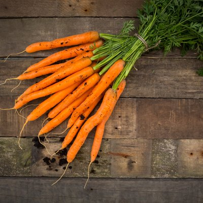 Bunch of carrots on wood