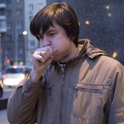 Young ill man coughing