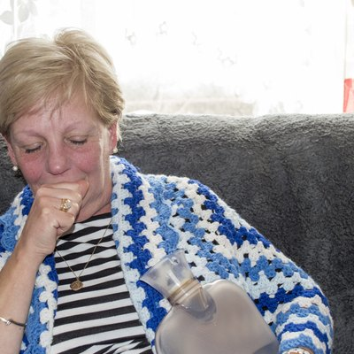 Mature woman with cold and flu