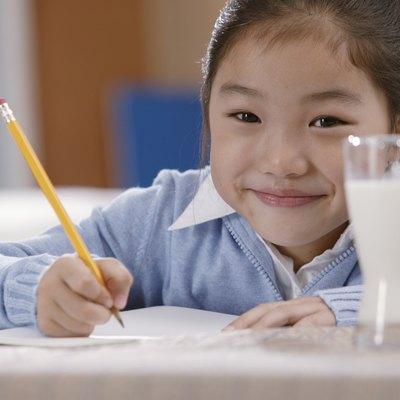 Portrait of girl doing homework