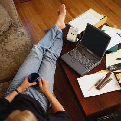 Man Relaxing on Couch with Laptop