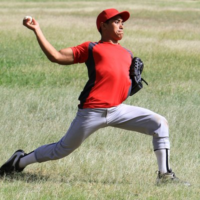 Baseball player throws a ball with strength