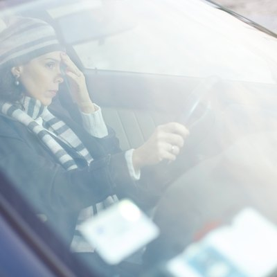 Frustrated Woman Driving a Car