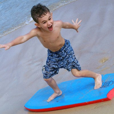 Boy on boogie board at the beach.