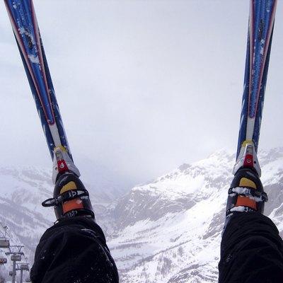 Skis over foggy Alps
