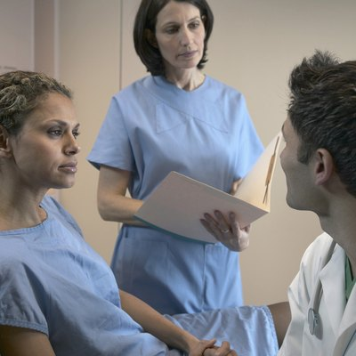 Male doctor examining a female patient