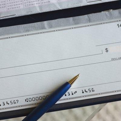 Blank check & pen