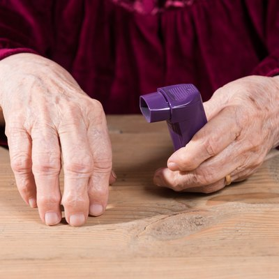 Woman's hands holding asthma inhaler