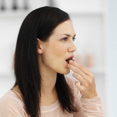 Woman eating a chocolate