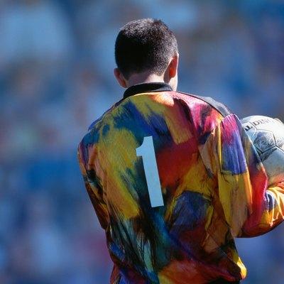 Soccer goalkeeper holding ball