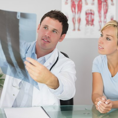 Content doctor showing a patient something on x-ray