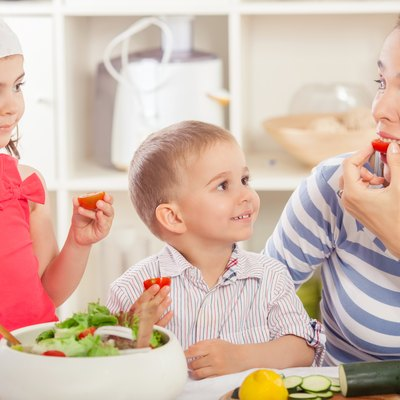 Family Eating Vegetable Salad